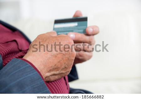 Senior hands with credit card,selective focus. - stock photo