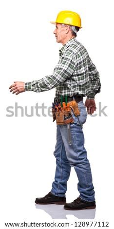 senior handyman walk isolated on white - stock photo