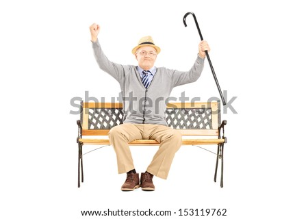Senior happy man sitting on a wooden bench and gesturing happiness isolated on white background - stock photo