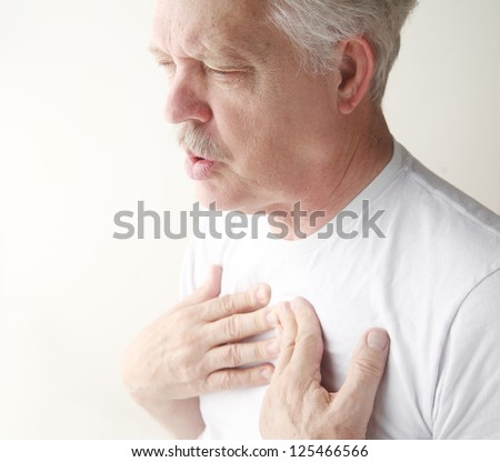 senior has trouble breathing with chest pain - stock photo