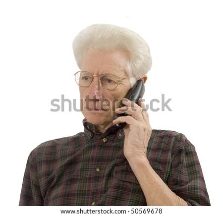 senior having a serious conversation on the phone - stock photo