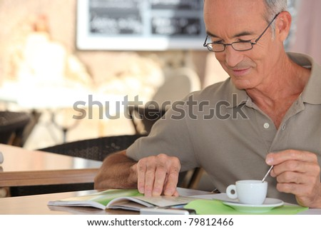 senior having cup of coffee - stock photo