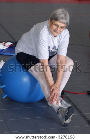 Senior Health and Fitness Leg Stretch - stock photo