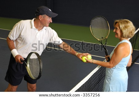 Senior Health and Fitness Tennis Match - stock photo