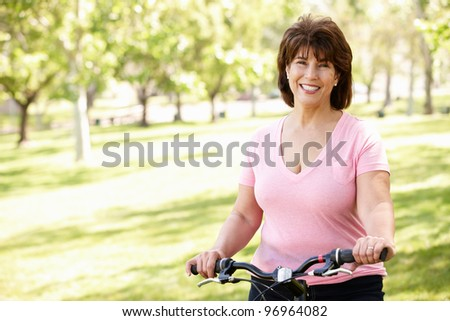 Senior Hispanic woman with bike - stock photo