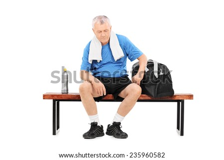 Senior in sportswear sitting on a bench isolated on white background - stock photo