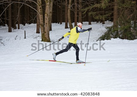 Senior in winter to cross country skiing on snow skis