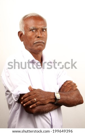 Senior Indian old man with serious expression. - stock photo