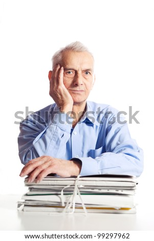 Senior is posing with files. Focus on face. - stock photo