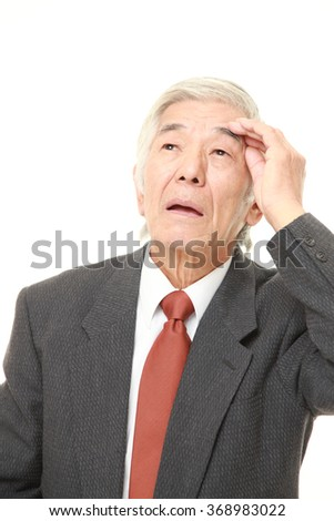 senior Japanese businessman has lost his memory - stock photo