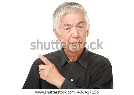 senior Japanese man in a black shirts doubting - stock photo
