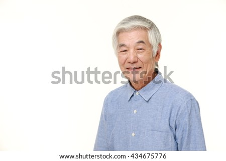 senior Japanese man in a blue shirts smiles - stock photo