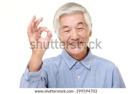 senior Japanese man showing perfect sign - stock photo