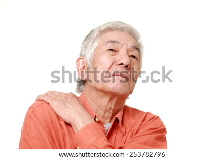 senior Japanese man suffers from neck ache