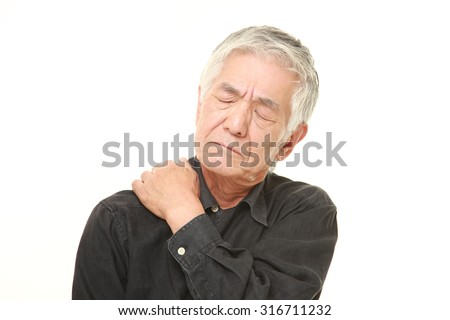senior Japanese man suffers from neck ache - stock photo