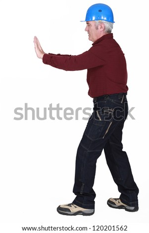 Senior laborer on white background - stock photo