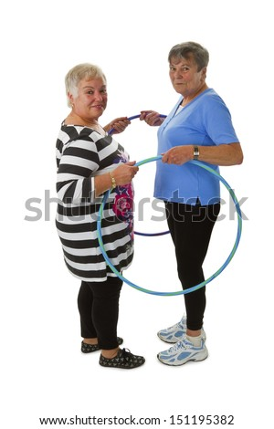 Senior lady doing gymnastic with hula hoop - isolated on white background - stock photo