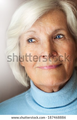 Senior lady looking thoughtful out, remembering something - stock photo