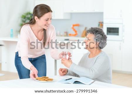 Senior lady needs to take her pills - stock photo