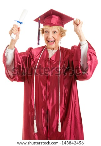 Senior lady olding her diploma, thrilled to finally be graduating.  Isolated on white. - stock photo