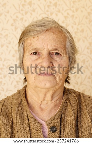 Senior lady portrait, Closeup portrait, elderly lady looking at camera - stock photo