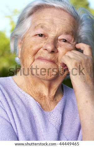 Senior lady. She is 93 year old at this picture. - stock photo