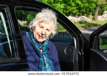 senior lady sitting in a  car in country scene