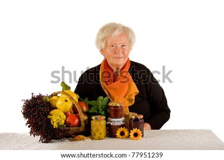 Senior lady with fresh fruits - stock photo