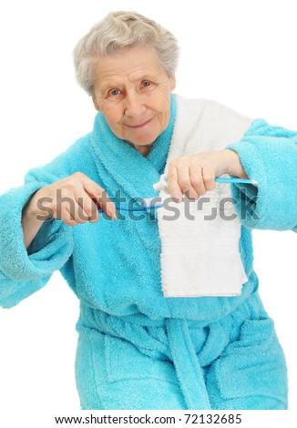 senior lady with toothbrush, isolated on white - stock photo