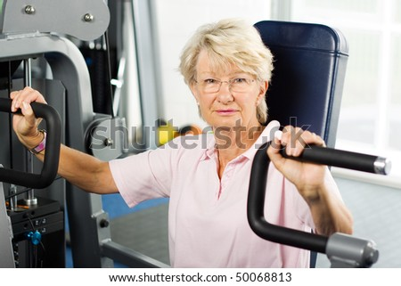 Senior lady working out at the gym