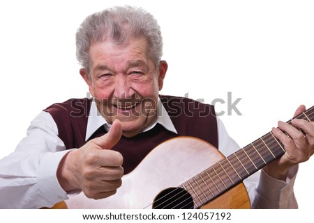 Senior learns to play the guitar - stock photo