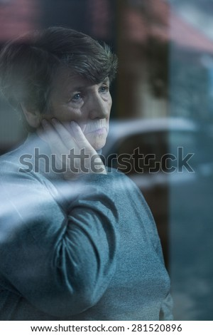 Senior lonely and sad woman suffering from depression - stock photo