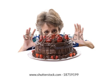 Senior looking at the tasty cake on white . - stock photo