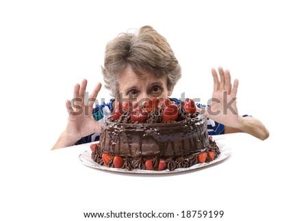 Senior looking at the tasty cake on white . - stock photo