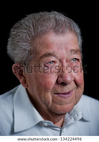 Senior looks smiling into the camera - stock photo
