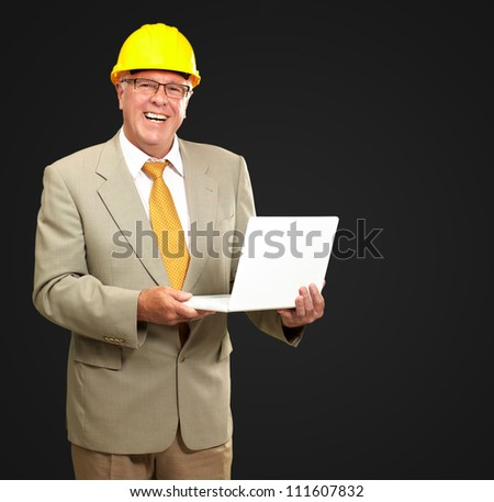 Senior Male Architect Standing With Touch pad On A Black Background - stock photo