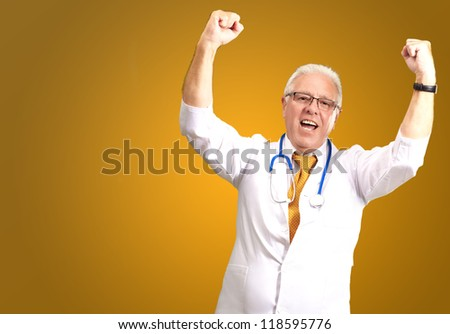 Senior Male Doctor In A Winning Gesture� Isolated On Yellow Background - stock photo