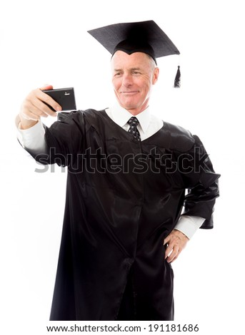 Senior male graduate taking picture of himself with a mobile phone