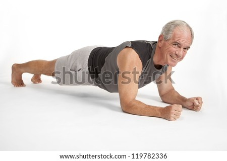 Senior male holds yoga pose - stock photo
