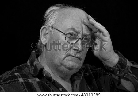 senior male worried concerned wearing glasses - stock photo