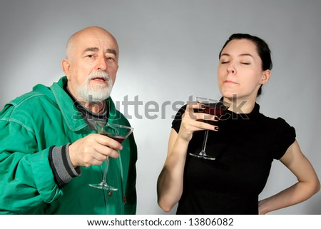 senior man and girl are tasting red wine