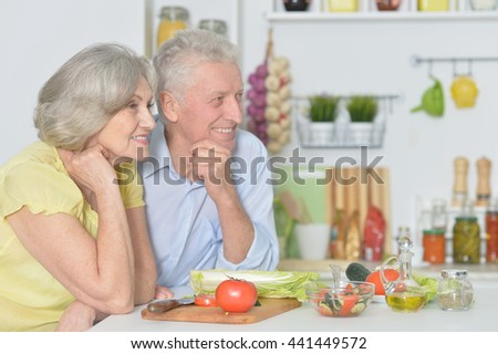 senior man and woman  in the kitchen