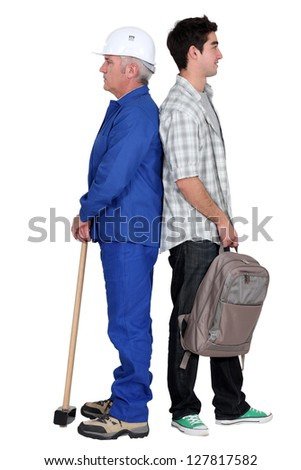 Senior man and younger with backpack - stock photo