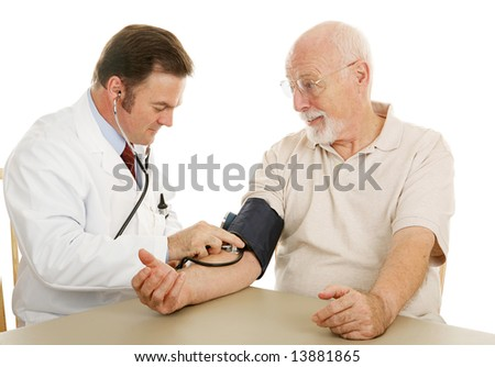 Senior man at the doctor having his blood pressure checked.  Isolated on white.