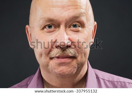 Senior man bald portrait smiling on grey background