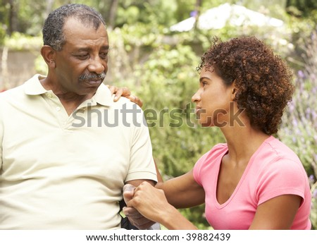Senior Man Being Consoled By Adult Daughter - stock photo