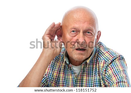 Senior man cupping his ear having difficulty hearing - stock photo