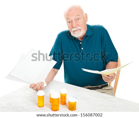 Senior man doesn't know how he will pay all his medical bills.  Isolated on white.   - stock photo