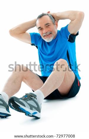senior man doing abs exercise in gym - stock photo