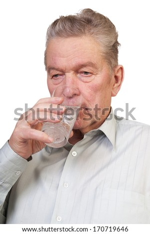 Senior man drinking water.